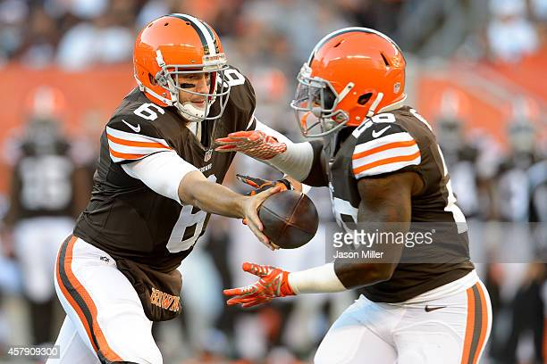 Quarterback Brian Hoyer hands off to cornerback Pierre Desir of the Cleveland Browns during the first half against the Oakland Raiders at FirstEnergy...