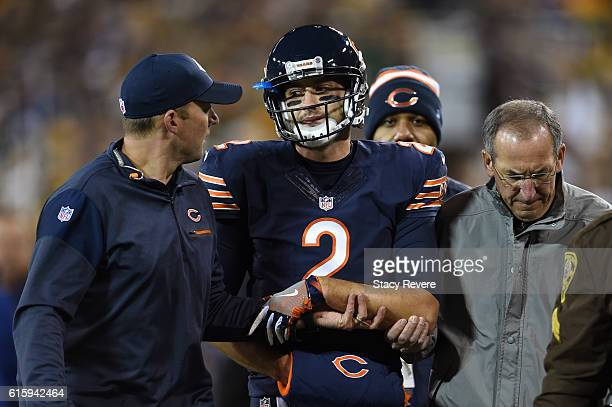 Quarterback Brian Hoyer of the Chicago Bears walks off of the field after being injured in the second quarter against the Green Bay Packers at...