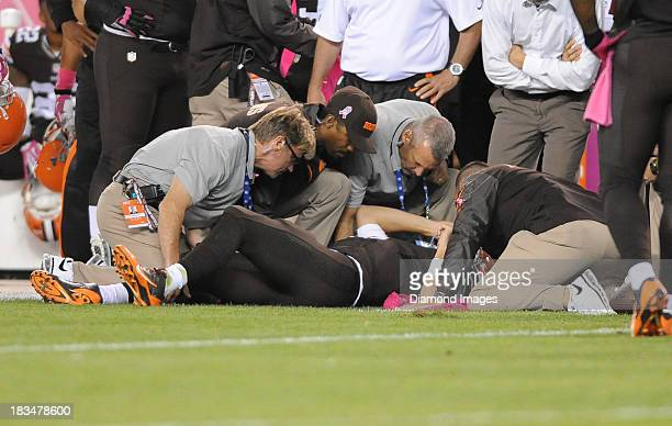 Quarterback Brian Hoyer of the Cleveland Browns is checked out by the medical staff after sustaining an injury on the field during a game against the...