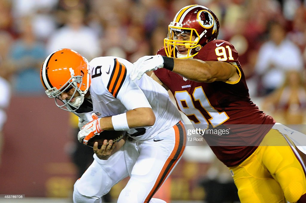 Quarterback Brian Hoyer #6 of the Cleveland Browns is sacked by outside linebacker Ryan Kerrigan #91 of the Washington Redskins during the first quarter of a preseason game at FedExField on August 18, 2014 in Landover, Maryland.