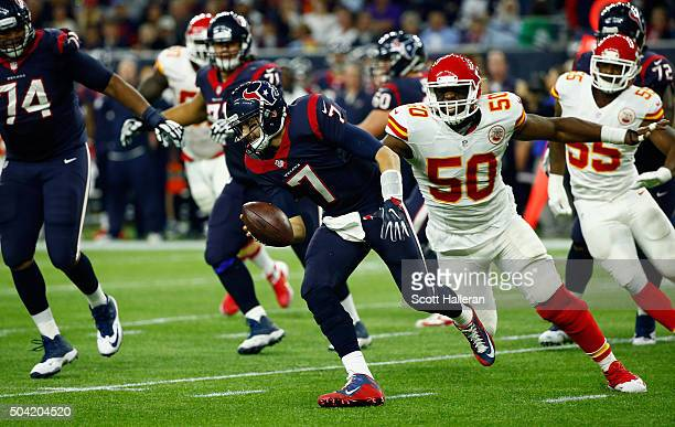 Quarterback Brian Hoyer of the Houston Texans scrambles against Justin Houston of the Kansas City Chiefs in the third quarter during the AFC Wild...