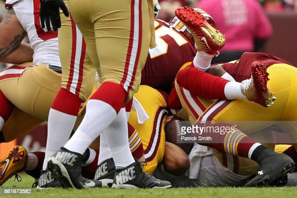 Quarterback Brian Hoyer of the San Francisco 49ers looks is sacked by defensive tackle Matthew Ioannidis of the Washington Redskins during the first...