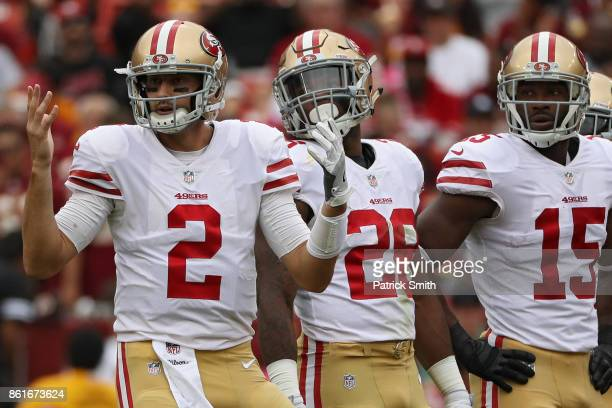 Quarterback Brian Hoyer of the San Francisco 49ers looks to the sideline with his hands in the air against the Washington Redskins during the first...