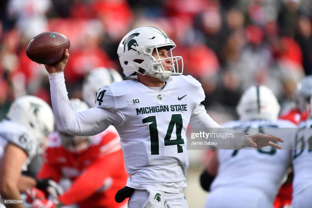Quarterback Brian Lewerke #14 of the Michigan State Spartans passes in the fourth quarter against the Ohio State Buckeyes at Ohio Stadium on November 11, 2017 in Columbus, Ohio. Ohio State defeated Michigan State 48-3.