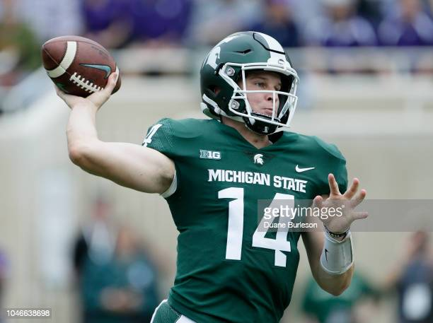 Quarterback Brian Lewerke of the Michigan State Spartans passes against the Northwestern Wildcats during the first half at Spartan Stadium on October...