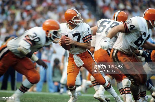 Quarterback Brian Sipe of the Cleveland Browns going back to pass during a game against the Houston Oilers on September 10 1981 in Cleveland Ohio