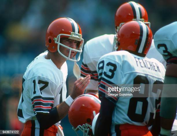 Quarterback Brian Sipe of the Cleveland Browns huddles with members of the offense including wide receiver Ricky Feacher during a National Football...