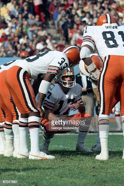 Quarterback Brian Sipe of the Cleveland Browns huddles with the offense during a National Football League game at Municipal Stadium circa 1977 in...