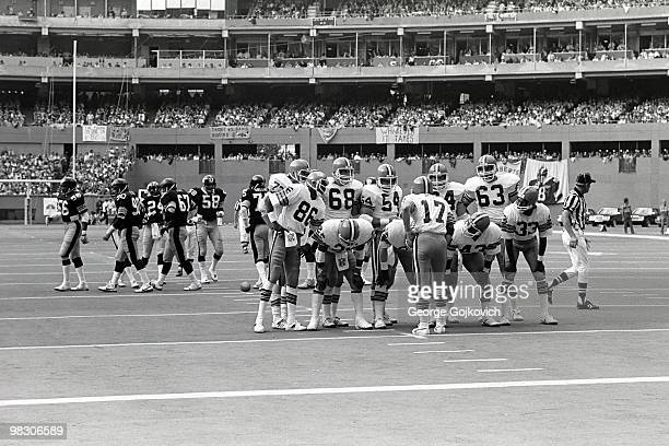 Quarterback Brian Sipe of the Cleveland Browns huddles with the offense including Dan Fulton Robert E Jackson Tom DeLeone Cody Risien Reggie Rucker...