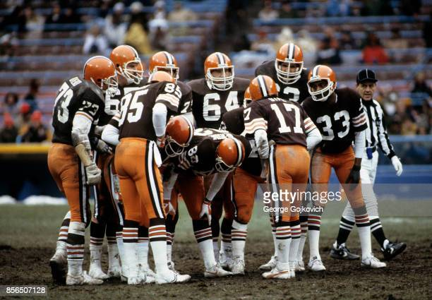 Quarterback Brian Sipe of the Cleveland Browns huddles with the offense including wide receiver Dave Logan tackle Doug Dieken guard Henry Sheppard...