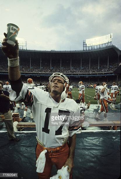 Quarterback Brian Sipe of the Cleveland Browns raises a cup to salute the crowd during a game on October 7 1981 against the Pittsburgh Steelers at...