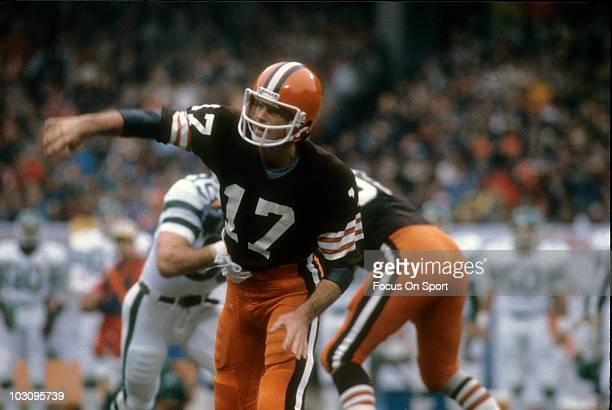 Quarterback Brian Sipe of the Cleveland Browns throws a pass against the New York Jets circa 1981 during an NFL football game at Cleveland Municipal...