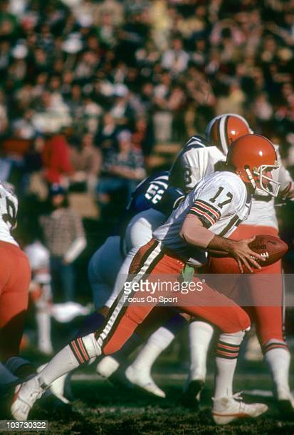 Quarterback Brian Sipe of the Cleveland Browns turns to hand the ball off against the Baltimore Colts during an NFL football game November 9 1980 at...