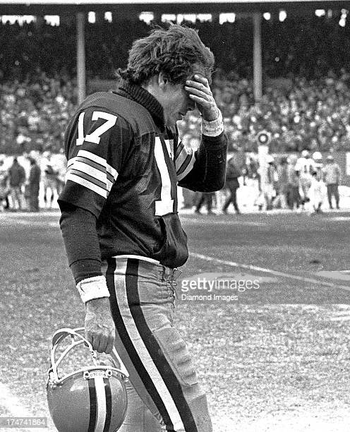 Quarterback Brian Sipe of the Cleveland Browns walks off the field after throwing an interception during an AFC Divisional playoff game against the...