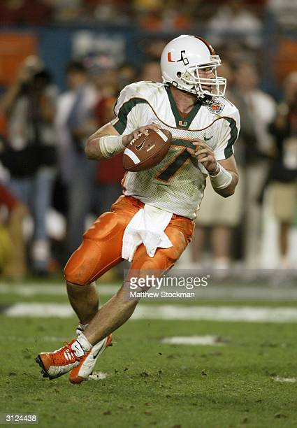 Quarterback Brock Berlin of the Miami Hurricanes drops back to pass during the 2004 Orange Bowl game against the Florida State Seminoles on January 1...