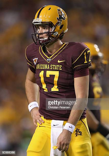 Quarterback Brock Osweiler of the Arizona State Sun Devils walks off the field after a turnover against the USC Trojans during the college football...