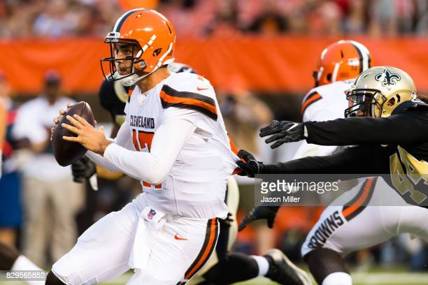 Quarterback Brock Osweiler of the Cleveland Browns escapes outside linebacker Hau'oli Kikaha of the New Orleans Saints during the first quarter of a...