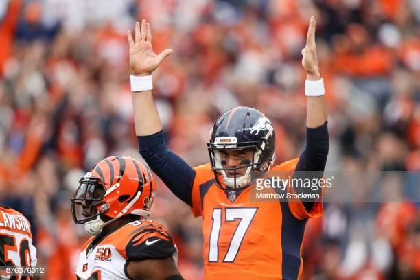 Quarterback Brock Osweiler of the Denver Broncos celebrates after a first quarter Denver Broncos touchdown against the Cincinnati Bengals at Sports...