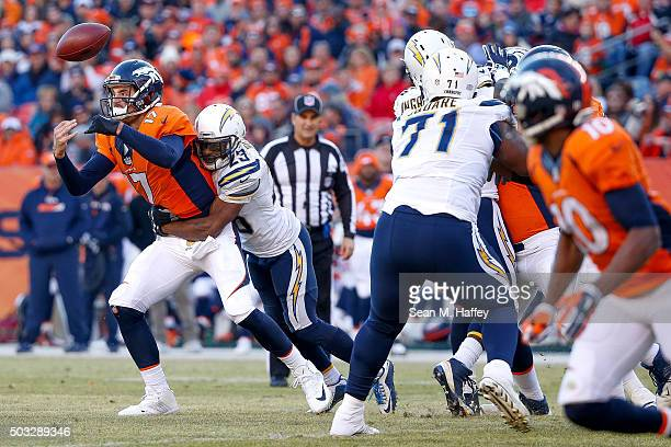 Quarterback Brock Osweiler of the Denver Broncos fumbles as he is hit by cornerback Steve Williams of the San Diego Chargers in the second quarter of...
