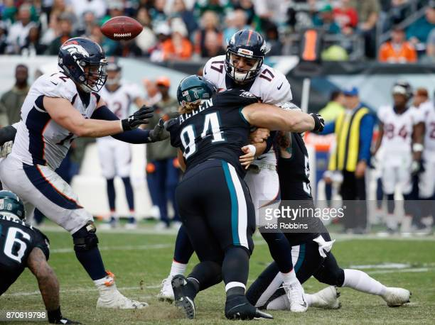Quarterback Brock Osweiler of the Denver Broncos fumbles the ball as he is sacked by defensive tackle Beau Allen of the Philadelphia Eagles during...