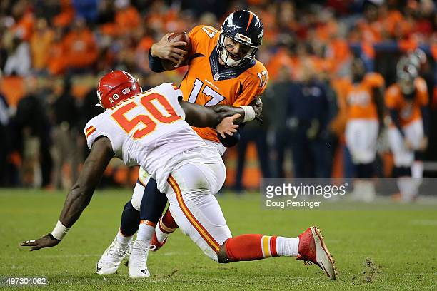 Quarterback Brock Osweiler of the Denver Broncos is sacked by linebacker Justin Houston of the Kansas City Chiefs in the fourth quater at Sports...