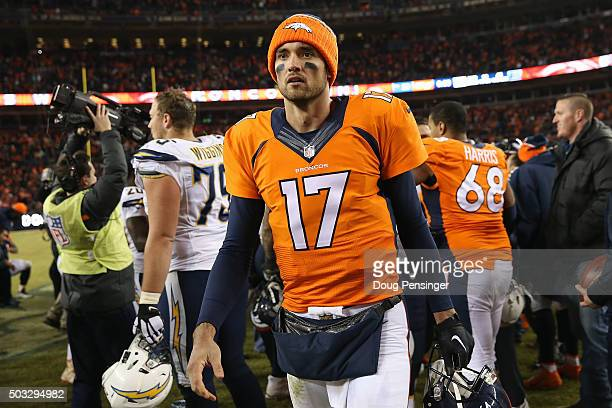 Quarterback Brock Osweiler of the Denver Broncos leaves the field after defeating the San Diego Chargers at Sports Authority Field at Mile High on...