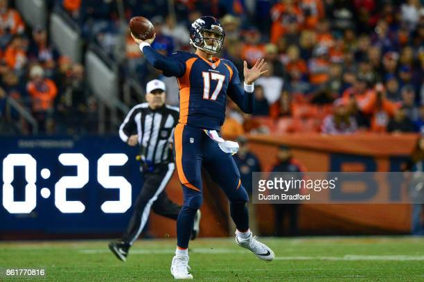 Quarterback Brock Osweiler of the Denver Broncos passes against the New York Giants in the second quarter of a game at Sports Authority Field at Mile...