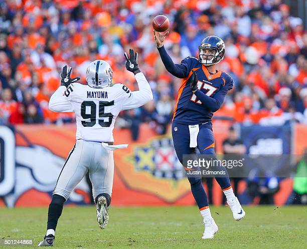Quarterback Brock Osweiler of the Denver Broncos passes under pressure by defensive end Benson Mayowa of the Oakland Raiders during a game at Sports...
