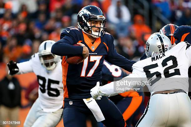 Quarterback Brock Osweiler of the Denver Broncos scrambles away from defensive end Khalil Mack and defensive end Benson Mayowa of the Oakland Raiders...