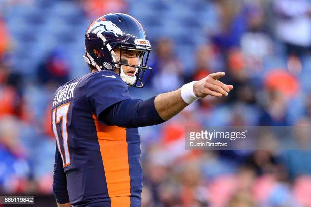 Quarterback Brock Osweiler of the Denver Broncos stands on the field as players warm up before a game against the New York Giants at Sports Authority...