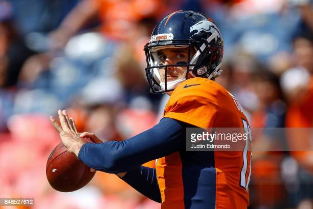 Quarterback Brock Osweiler of the Denver Broncos throws as he warms up before a game against the Dallas Cowboys at Sports Authority Field at Mile...