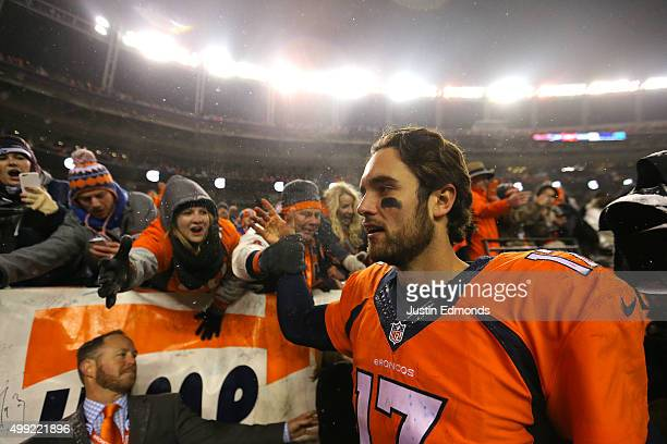 Quarterback Brock Osweiler of the Denver Broncos walks off of the field after defeating the New England Patriots 3024 in overtime at Sports Authority...