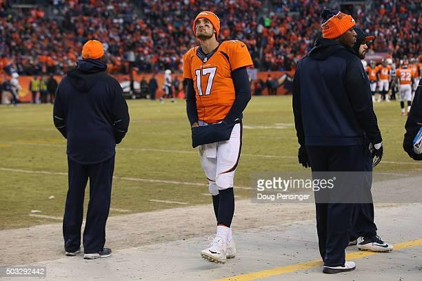 Quarterback Brock Osweiler of the Denver Broncos walks the sideline after quarterback Peyton Manning of the Denver Broncos entered the game against...