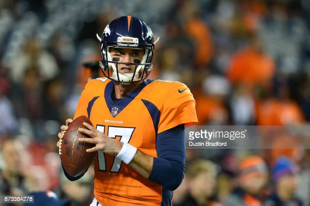 Quarterback Brock Osweiler of the Denver Broncos warms up before a game against the New England Patriots at Sports Authority Field at Mile High on...