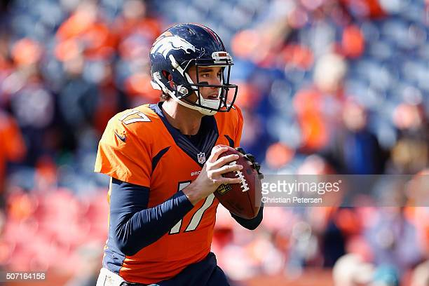 Quarterback Brock Osweiler of the Denver Broncos warms up before the AFC Championship game against the New England Patriots at Sports Authority Field...