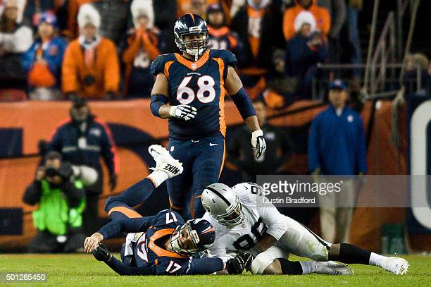 Quarterback Brock Osweiler of the Denver Broncos was hit at the end of a play which effectively ended the game by nose tackle Denico Autry of the...