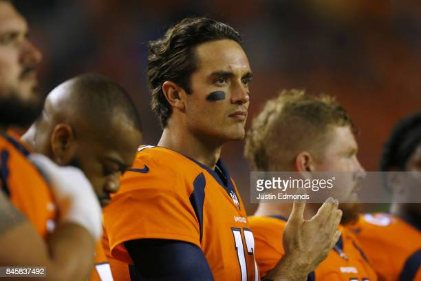 Quarterback Brock Osweiler of the Denver Broncos watches opening ceremonies against the Los Angeles Chargers at Sports Authority Field at Mile High...