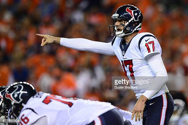Quarterback Brock Osweiler of the Houston Texans calls out plays at the line of scrimmage in the second half of the game against the Denver Broncos...