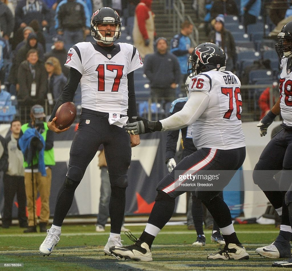 Quarterback Brock Osweiler #17 of the Houston Texans reacts after making a rushing touchdown against of the Tennessee Titans during the second half at Nissan Stadium on January 1, 2017 in Nashville, Tennessee.