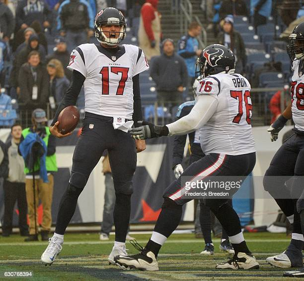 Quarterback Brock Osweiler of the Houston Texans reacts after making a rushing touchdown against of the Tennessee Titans during the second half at...