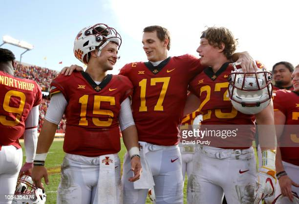 Quarterback Brock Purdy of the Iowa State Cyclones celebrates with teammates quarterback Kyle Kempt and linebacker Mike Rose of the Iowa State...