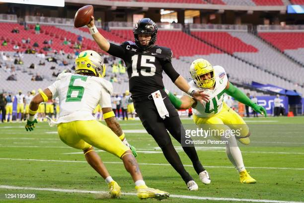 Quarterback Brock Purdy of the Iowa State Cyclones crosses the goal line to score a 1-yard touchdown past Nick Pickett and Mase Funa of the Oregon...