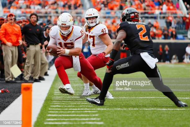 Quarterback Brock Purdy of the Iowa State Cyclones stretches for a first down against cornerback Tanner McCalister of the Oklahoma State Cowboys in...