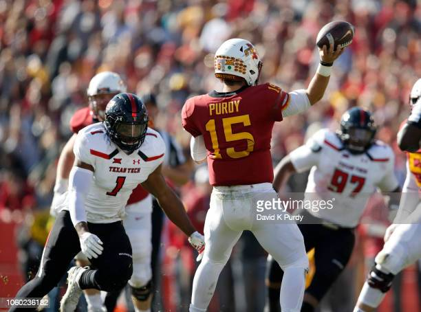 Quarterback Brock Purdy of the Iowa State Cyclones throws under pressure from linebacker Jordyn Brooks of the Texas Tech Red Raiders in the first...