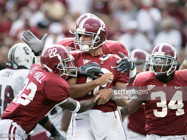 Quarterback Brodie Croyle of the Alabama Crimson Tide is congratulated by teammates after rushing for a 15yard touchdown in the first quarter against...