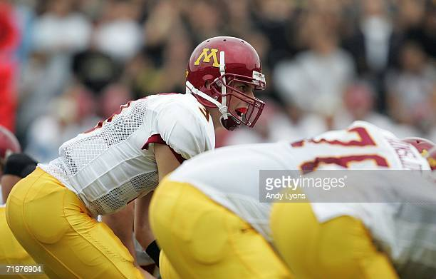 Quarterback Bryan Cupito of the Minnesota Golden Gophers calls out singnals as he stands under center at the line of scrimmage against the Purdue...
