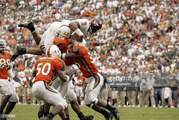 Quarterback Bryan Randall of the Virginia Polytechnic Institute and State University Hokies is stopped by defensives back Sean Taylor and Maurice...