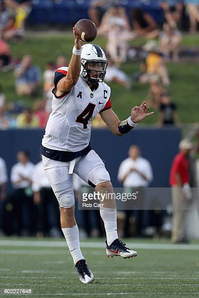 Quarterback Bryant Shirreffs of the Connecticut Huskies throws a pass against the Navy Midshipmen in the second half of the Huskies 2824 loss at...
