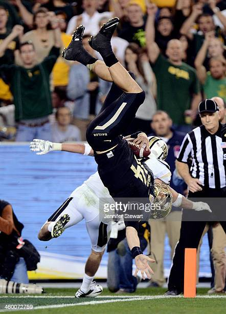 Quarterback Bryce Petty of the Baylor Bears scores a touchdown as defensive back Sean Maag of the UCF Knights defends during the Tostitos Fiesta Bowl...
