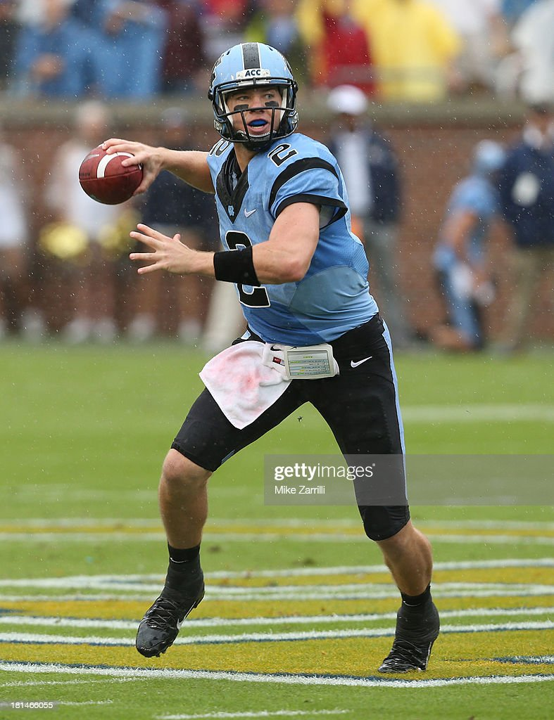 Quarterback Bryn Renner #2 of the North Carolina Tar Heels scrambles and throws a pass during the game against the Georgia Tech Yellow Jackets at Bobby Dodd Stadium at Historic Grant Field on September 21, 2013 in Atlanta, Georgia.